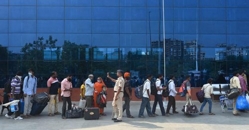 Experts call for travel restrictions as COVID-19 cases surge in India
