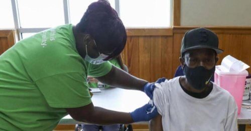 After son dies of COVID, mother holds vaccine drive at his funeral