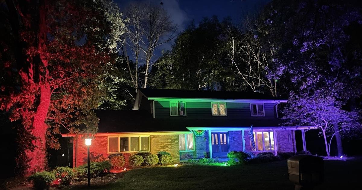 They weren't allowed to fly their pride flag, so this couple lit up their home with a rainbow light display