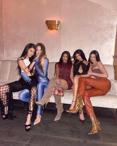 The Kardashian sisters just unveiled identical hair in their latest family photo