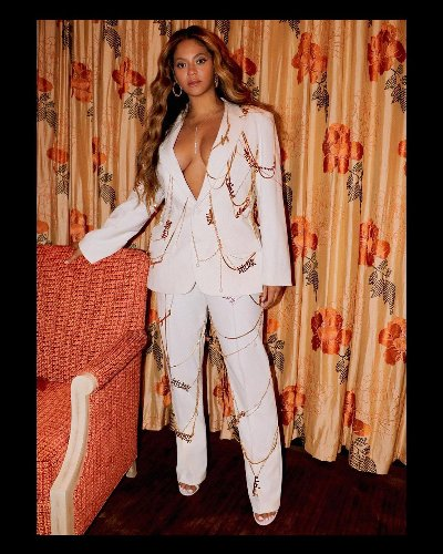 Beyoncé Stuns in Low-Cut White Power Suit