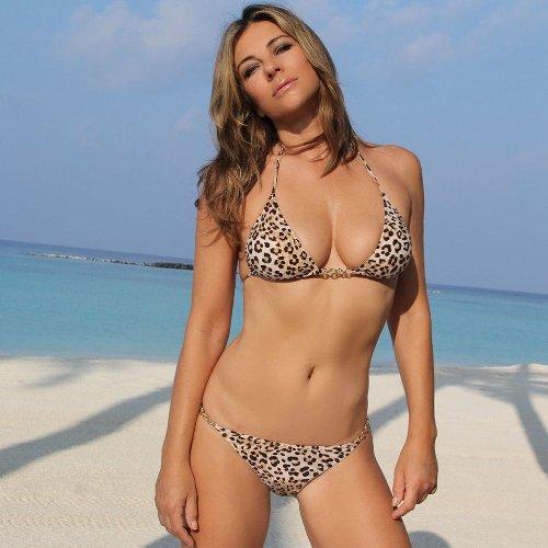 Elizabeth Hurley, 55, Flaunts Super-Toned Abs While Wearing Her 'Favorite' Animal-Print Bikini