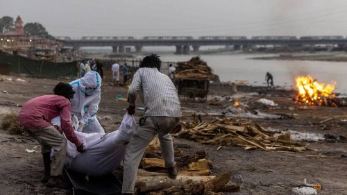 Bodies float down Ganges as nearly 4,000 more die of COVID-19 in India