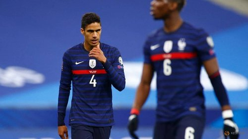 Soccer-Taking the knee can cause tension: France's Varane