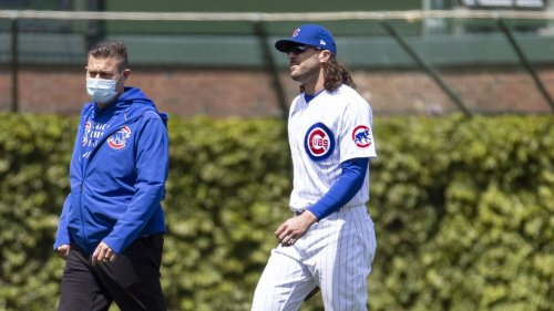 Chicago Cubs' Jake Marisnick goes on the IL with a right hamstring strain, while Javier Báez is scratched from tonight's lineup with lower back tightness