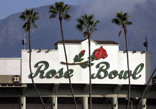 College Football Playoff semifinal game is moved from the Rose Bowl to AT&T Stadium in Texas — with families allowed to attend