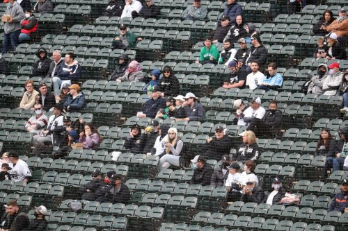 Baseball fans are back with masks and social distancing. Here's what Cubs and White Sox fans said about returning to the ballpark — and what can be improved.