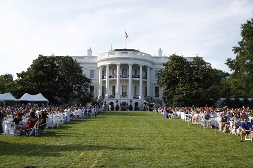President Donald Trump entices masses with White House event even as officials across US warn against large July Fourth crowds