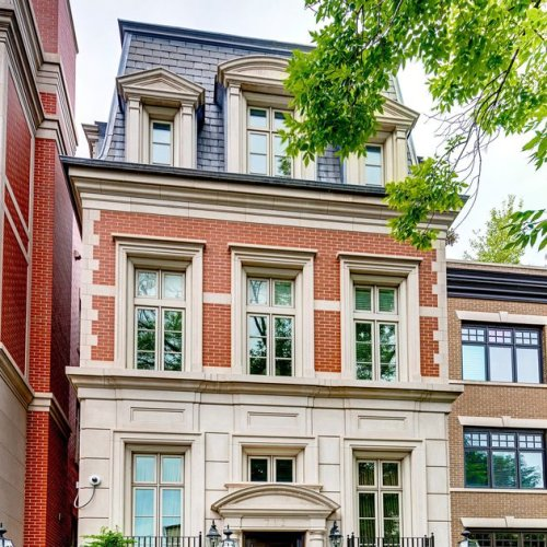 Park West 7-bedroom home with grand, circular staircase: $3.2M