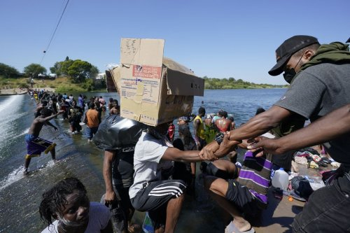 Thousands of Haitian migrants converge on Texas border town, presenting the Biden administration with a new challenge