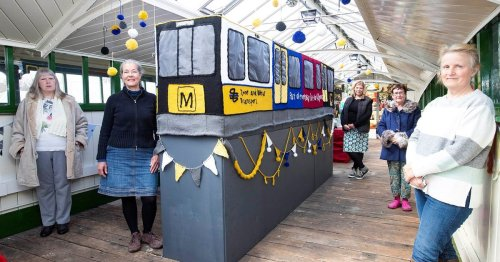 Knitters knit a 12ft Metro carriage to mark Metro's 40th anniversary