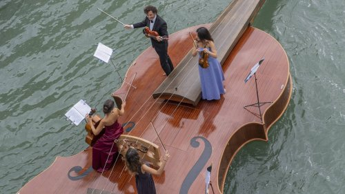 A sublime string quartet serenades Venice's canals with Vivaldi, on a boat shaped like a violin