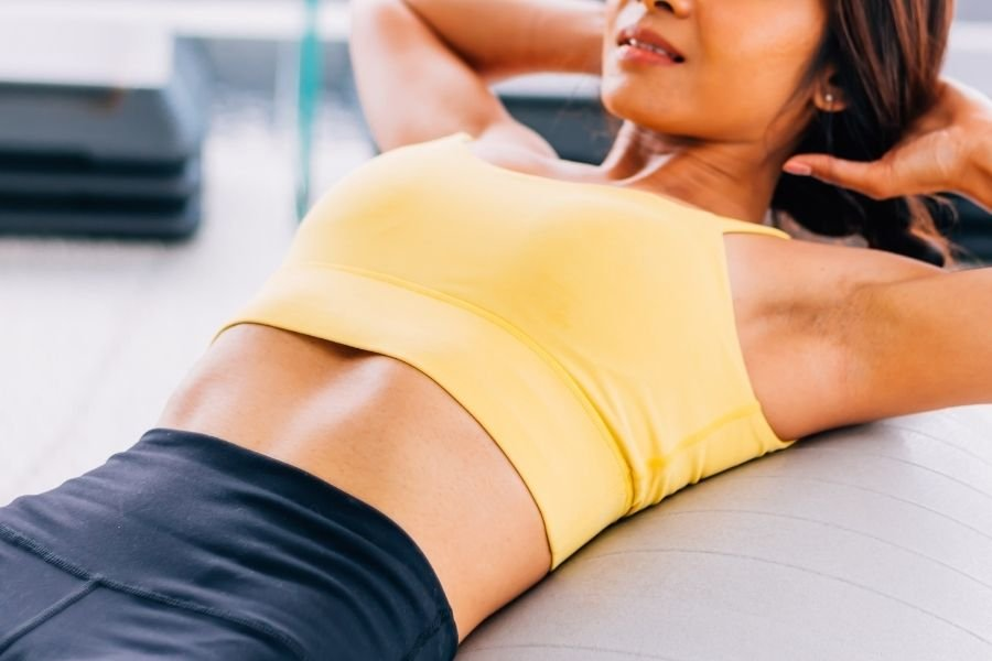 You Need These Crunch Variations to Get a Flat Tummy, Say Top Trainers - cover