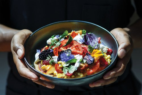 Vegan summer salad with berry coconut dressing