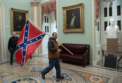 Man who carried Confederate flag to Capitol during Jan. 6 riot indicted