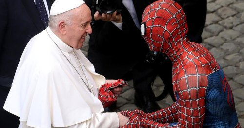 Spider-Man meets the pope, slings him a Marvel mask