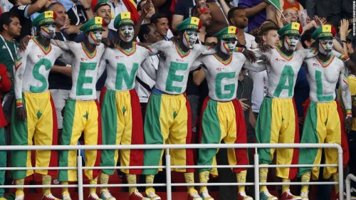 Japan and Senegal fans help to clean up World Cup stadiums