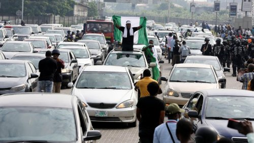 Police fire tear gas as protesters honoring victims of Lekki toll gate shooting spill on to streets