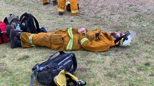 Photos show exhausted Australian firefighters on break from battling bushfires