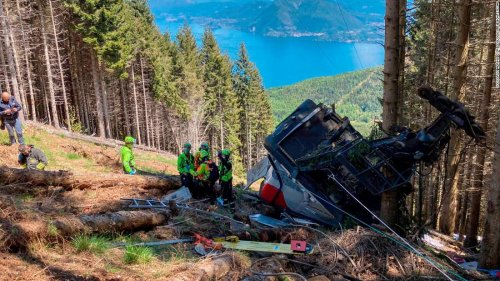 At least 14 killed as Italian cable car plunges into woodland