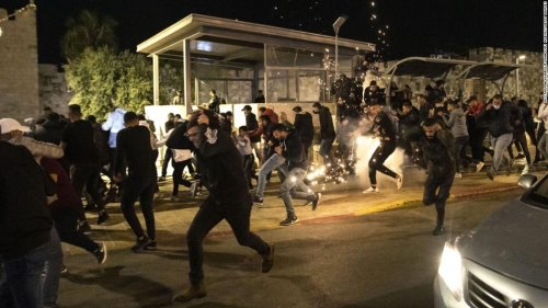 Dozens of Palestinians injured in police clashes as Jewish extremists chanting 'Death to Arabs' march in Jerusalem