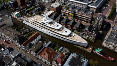 Huge superyacht squeezes down narrow Dutch canals