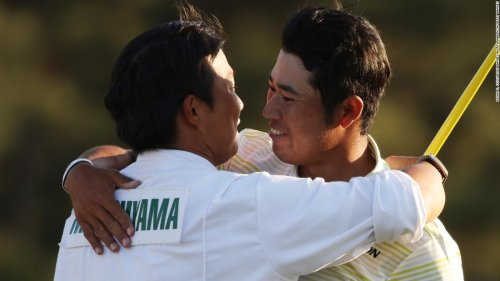 Hideki Matsuyama's caddie bowing respectfully to Augusta symbolizes emotional Masters win for a proud Japan