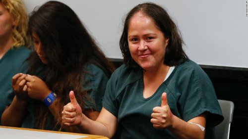 Mother accused of fatally stabbing family gives thumbs-up in court   CNN