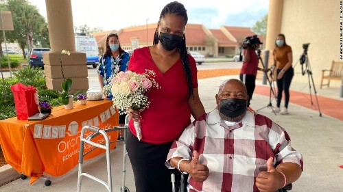 A couple got married in a hospital parking lot after the groom recovered from Covid-19