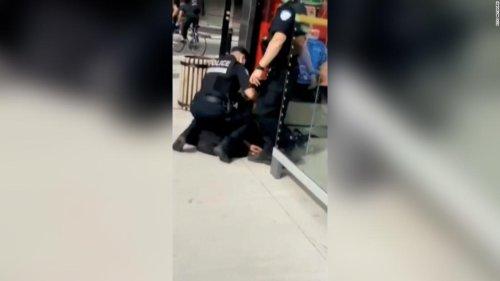 Canadian legislator calls for investigation into video of a police officer kneeling on a teenager's neck
