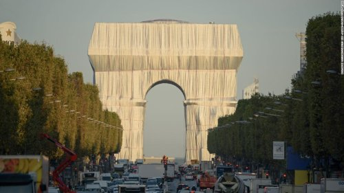 The Arc de Triomphe is wrapped in fabric, a vision six decades in the making