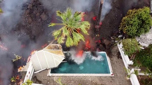 Lava swallows swimming pool and homes in Spain