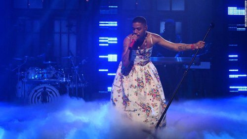 Kid Cudi sports a floral dress during SNL performance while honoring Kurt Cobain and Chris Farley