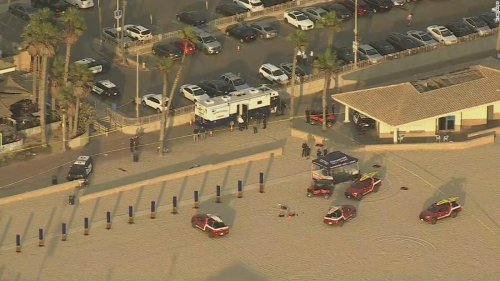 Police say they shot and killed an armed man near where crowds had gathered for the US Open of Surfing event