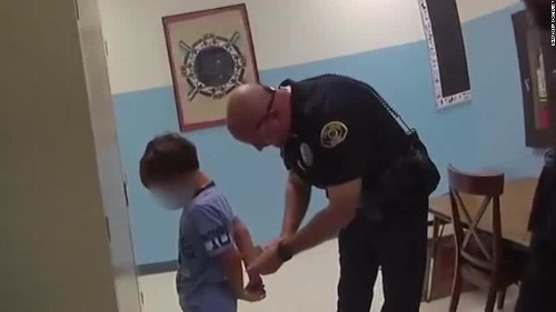 Key West Police arrested an 8-year-old at school. His wrists were too small for the handcuffs