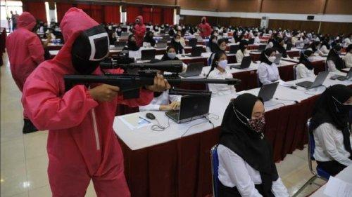 So September 2021: 'Squid Game' guards invigilate civil servant candidates in Indonesia