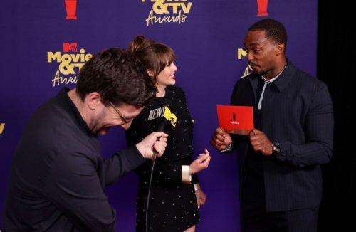 Scarlet Witch Actress Elizabeth Olsen Photo Bombs Captain America Anthony Mackie at MTV Movie & TV Awards