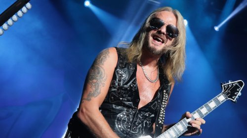 """Judas Priest's Richie Faulkner hospitalized with """"major heart condition issues,"""" band postpones tour dates"""