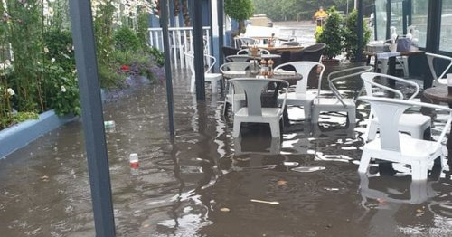 First day of opening a washout for flooded Cork Cafe submerged in 3 ft of water