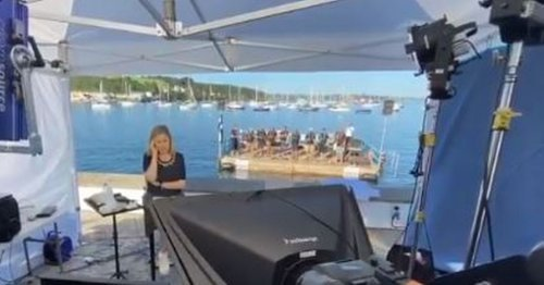 Brilliant moment CNN news anchor is interrupted by Cornish singers