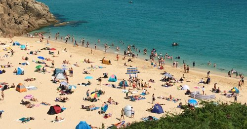 Gridlock as tourists flock to famous beach and park everywhere