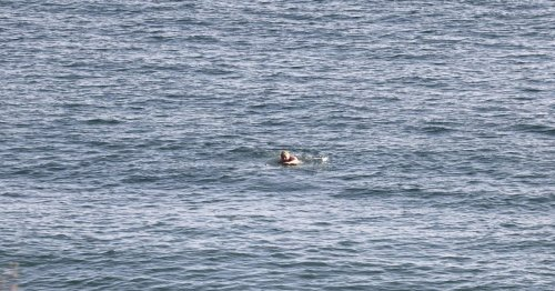 Boris Johnson spotted swimming and running in Carbis Bay