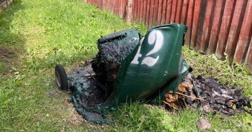 Warning as bin melts after garden waste inside spontaneously caught fire