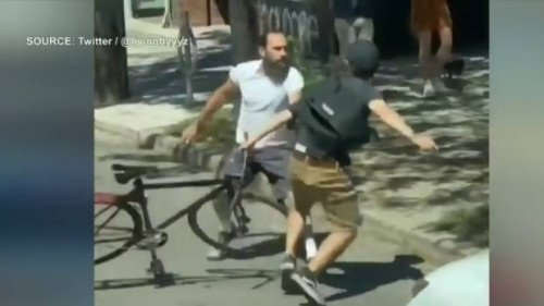 Police investigating after violent altercation between driver and cyclist captured on video