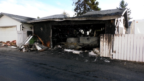 Fire nearly destroys neighbouring garages and vehicles