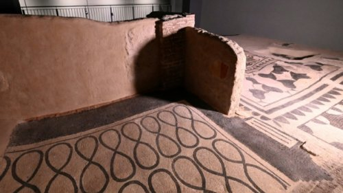 Ancient Roman 'domus' with mosaic floors tucked under modern flats