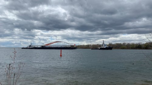 'Iconic' bridge sails into Toronto harbour, one step closer to city's newest island