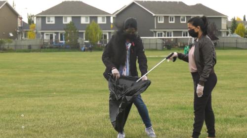 Ismaili community celebrates civic day by tidying local park