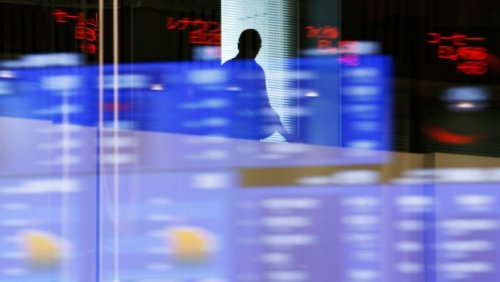 North American stock markets up in late-morning trading, loonie edges up