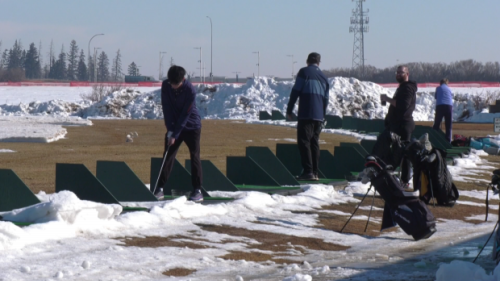 Golfers out in full force at driving range this warm Friday